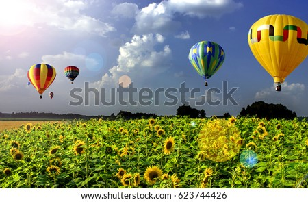 Air balloons flew against the sky before a thunderstorm. - Shutterstock ID 623744426