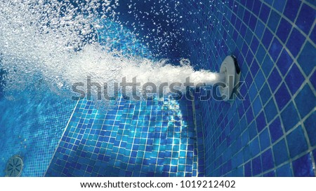 Air bubbles from jacuzzi jet in bubbly blue water in a thermal spa pool, abstract background Photo stock ©
