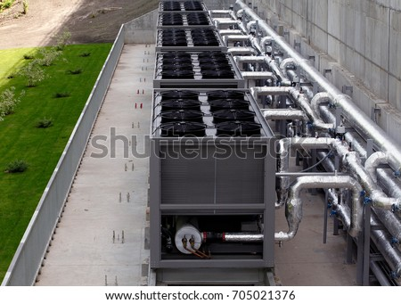 Air chiller. Sets of cooling towers in data center building. #705021376