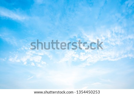Air clouds in the blue sky. #1354450253