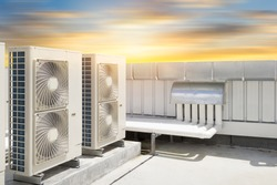 Air compressor or air condenser unit located on roof deck building to heat released transferred to surrounding environment, Compressor is part of cooling function and air conditioning HVAC systems.