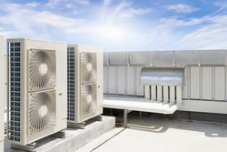 Air compressor or condenser unit on roof deck. That is part of mini split system or ductless system type. For removing heat and moisture from indoor or room. Also temperature and humidity control.