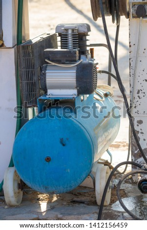 air compressor pump or electrical device or machine at a gas or petrol station in the Kgalagdi Transfrontier National Park, South Africa which is used for pumping up car tyres or tires