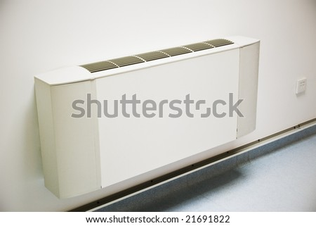 air-conditioner unit on white wall