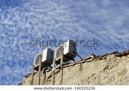 air conditioners on an outside wall in France