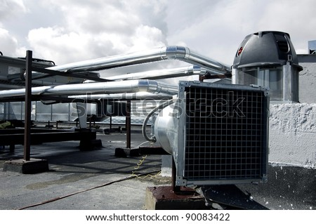 Air-conditioning and heat ducts on a modern building roof. Useful file for your company specialized in heating and air-conditioning systems.