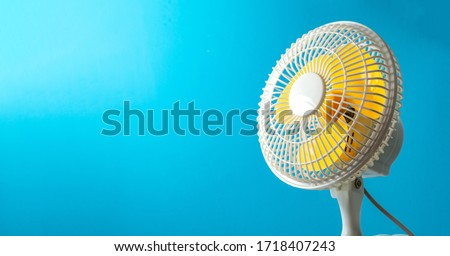 air conditioning fan - yellow blades in white safety cage on blue - air condition repair and comfort temperature concept banner Stockfoto ©