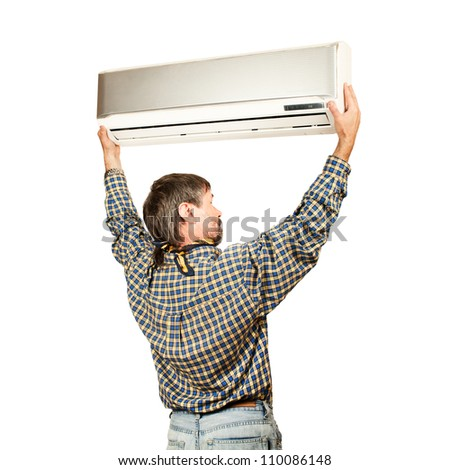 Air conditioning master installing a new air conditioner. Isolated on a white