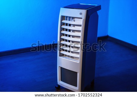 Air conditioning. Mobile air purifier with. Portable conditioner. Cleaning the air in the apartment. Temperature cooling in the room. Concept -  temperature reduction. Mobile air conditioning.