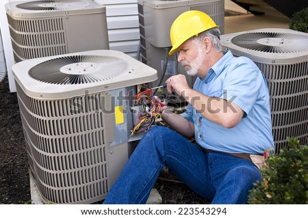 Air Conditioning Repairman At Work