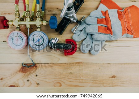 Air Conditioning Technician. manometers measuring equipment for filling air conditioners,gauges.Tools for HVAC