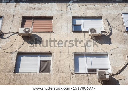 Air Conditioning Units, or AC, on display with their fans on a decaying facade of an old building of Belgrade, Serbia, Europe. They are used to cool down interiors, but consume a lot of electricity