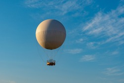 Air excursion balloon for passengers against the blue sky. Tbilisi