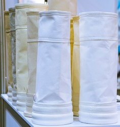 air filter for dust collector system ; Spare part filter bag is for  collect small particles ; engineering equipment industrial background.