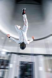 Air. Flying people in wind tunnel air . indoor skydiving