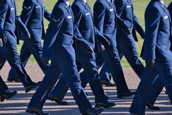Air Force basic training graduation parade, new airmen marching.