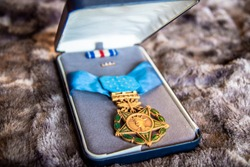 Air Force medal of honor in case with silver star ribbon.