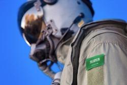 Air force pilot flight suit uniform with Saudi Arabia flag patch. Military jet aircraft pilot