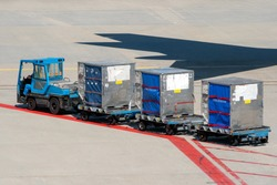 Air freight being transported on a loading platform on an airport