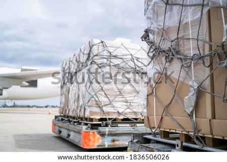 air freight cargo on dolly trailer waiting to be loaded onto aircraft Stock photo ©