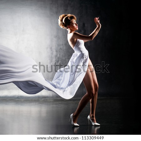 Air girl in fluttering white dress