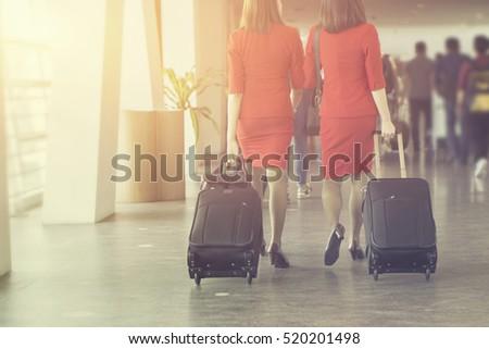 air hostes  women pulling...