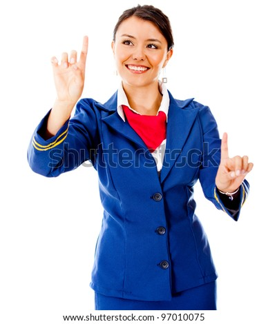 Air hostess pointing two destinations - isolated over a white background