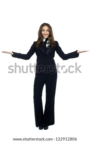 Air hostess welcoming the passengers. Isolated over white.