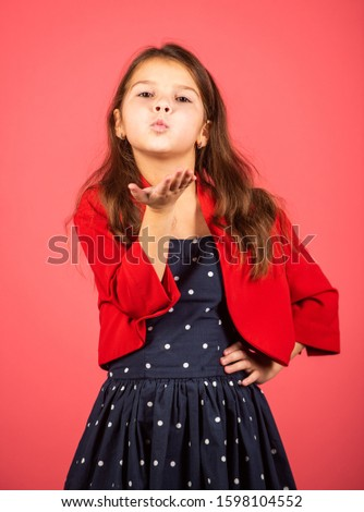 Air kissing. Little child send air kiss. Small girl in fashion style. Style and fashion. Keep elegance in style. Fashion style for festive days. Beauty salon.