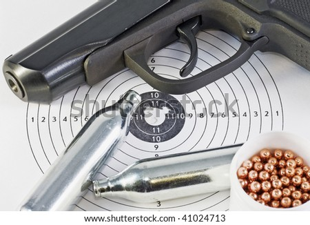 Air pistol and spare parts for weapons lie on the hole in the