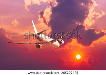 air plane flying with sunset - Shutterstock ID 265209425