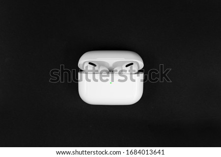 Air Pods Pro. with Wireless Charging Case. New Airpods pro on black background. Airpods Pro. Copy space