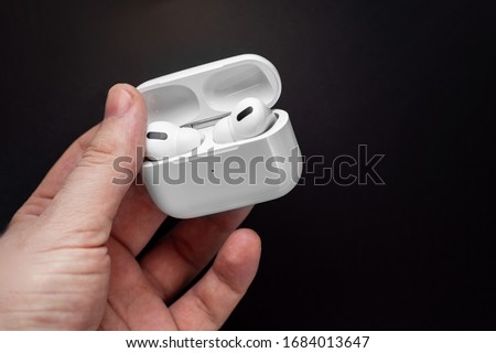 Air Pods Pro. with Wireless Charging Case. New Airpods pro on black background. Airpods Pro. Copy space.EarPods