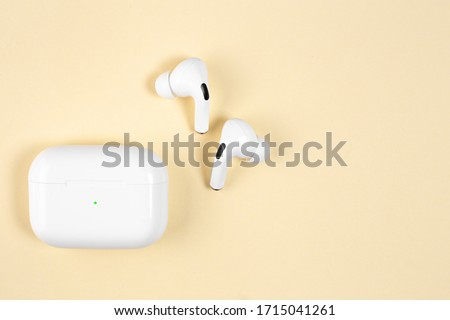 Air Pods Pro. with Wireless Charging Case. New Airpods pro on yellow background. Airpods Pro. Copy space.EarPods