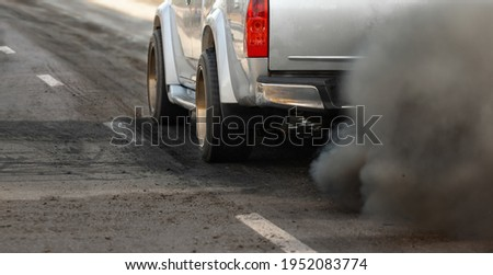 air pollution crisis in city from diesel vehicle exhaust pipe on road Stock photo ©
