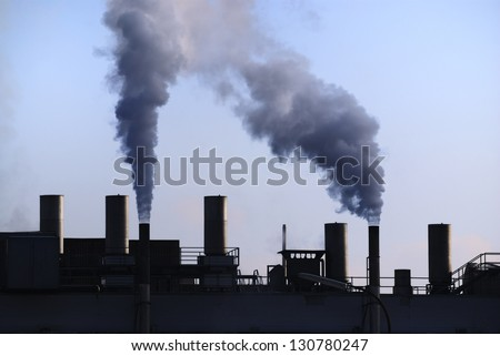 Air pollution - dirty smoke comming out of a chimney