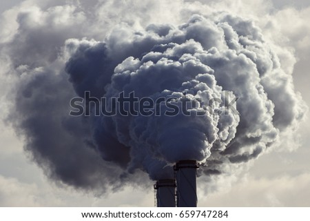 Air pollution from power plant chimneys. #659747284