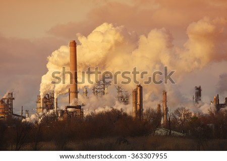 Air pollution from smoke stacks at oil refinery