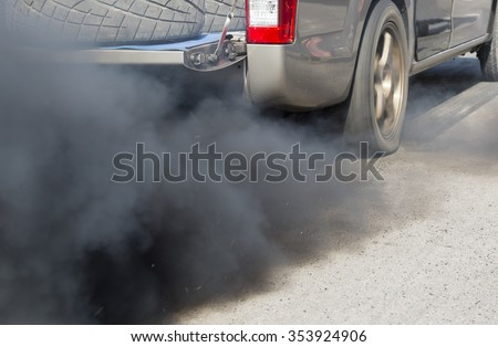 Air pollution from vehicle exhaust pipe on road #353924906
