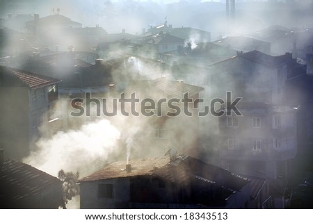 air pollution image of houses and smoke in winter