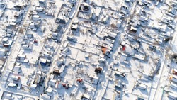 Air Shooting Winter Village in Russia. Aerial View. Quadrotor Filming