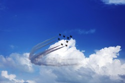 air show performance with white trajectory line