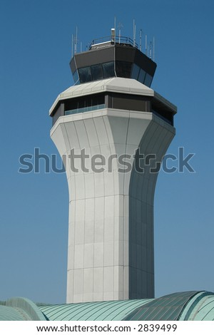 Air traffic control tower against blue sky