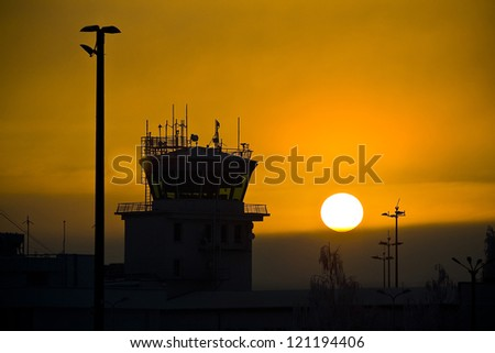 Air traffic control tower on sunset - stock photo