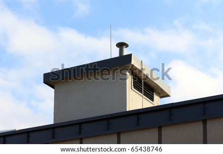 Air vents on top of a roof