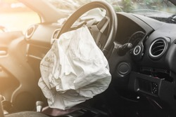 Airbag exploded at a car accident with illuminated