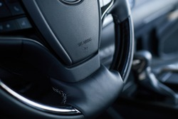 Airbag icon on steering wheel of car close up. The concept of selling a new car in showroom