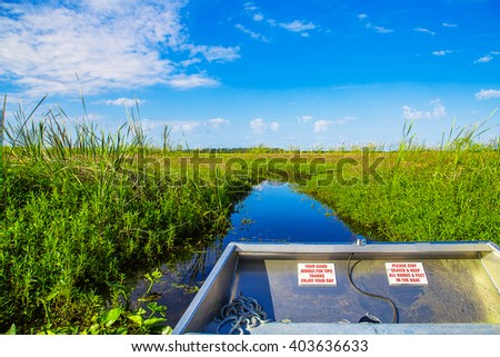 Stock Photo Airboat in Florida going through the lake looking for alligators
