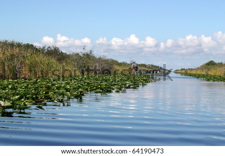 Airboat on tropical wetland in Everglades National Park in Florida
