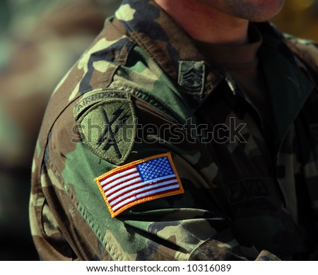 Airborne and USA flag patch on soldiers arm